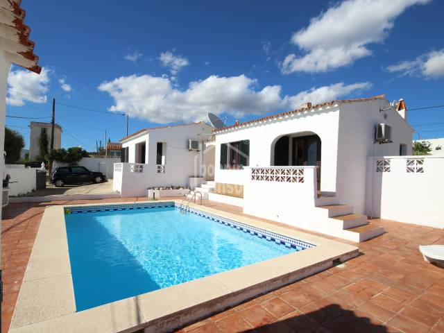 Two villas of 50m² each on the same plot, sharing a large swimming pool in Calan Porter, Menorca