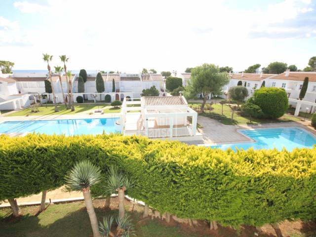 First floor apartment in a magnificent complex with gardens and two swimming pools near the beach of Son Xoriguer, Ciutadella Menorca