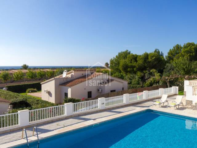Two terraced houses with sea views in a complex of four, Torre Soli, Menorca.