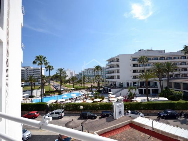2nd  floor apartment in front line building with open views over the mountain and resort of Cala Millor