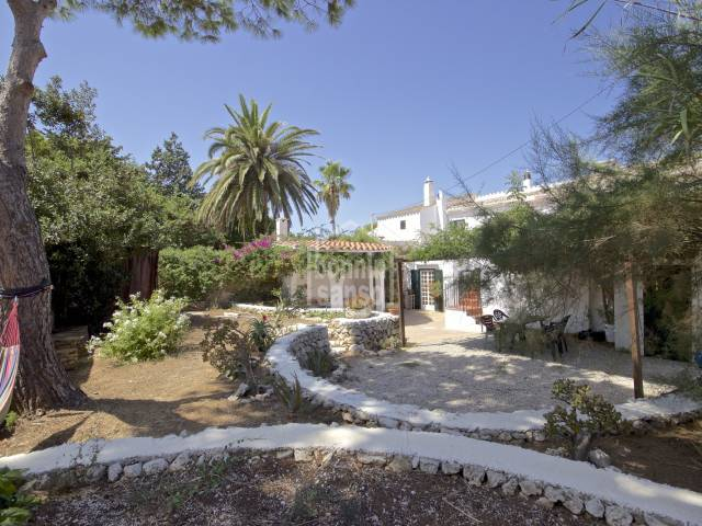 Semi-detached house hidden among lush gardens in Trebaluger, Menorca