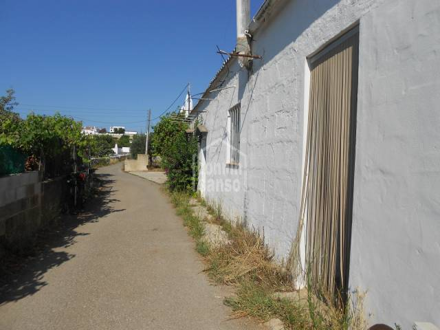 Land with a small house in Es Migjorn Gran, Menorca.