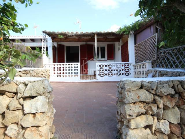 Small semi-detached  beach house with garden and sea views, Son Ganxo. Minorca
