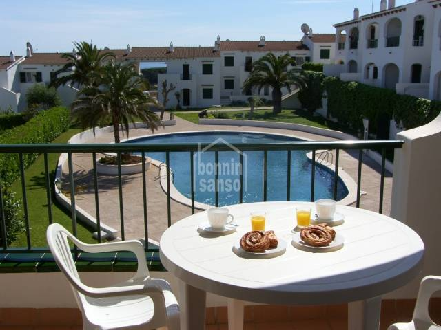 First floor corner apartment set in an attractive complex with communal  sunbathing terraces and swimming pool, in Addaya.