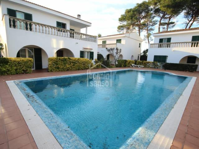 Beautiful duplex villa with communal pool next to the beach of Cala Blanca, Ciutadella, Menorca